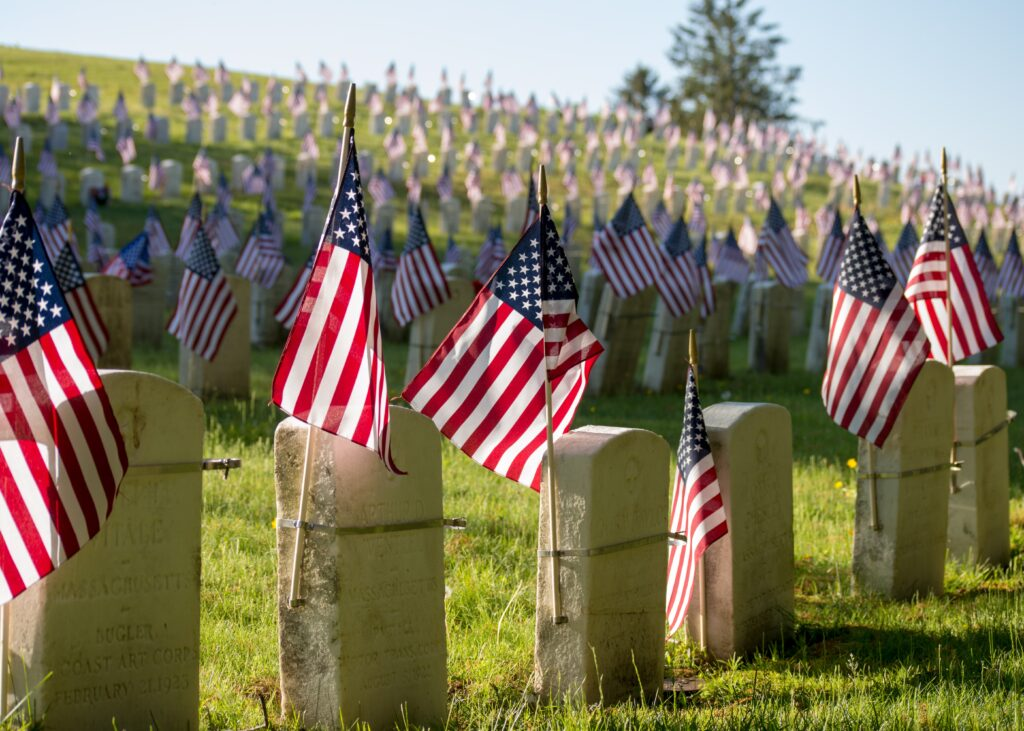 american flags on tombstone for memorial day